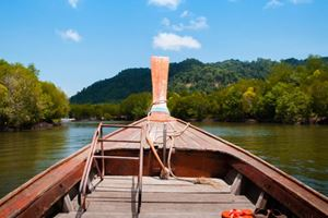 Longtail-fishing-boat-exploring-mangrove-forest-and-canal-in-Koh-Lanta,-Krabi,-Thailand.jpg