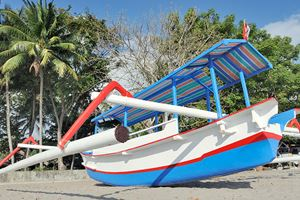 Asian-outrigger-boat-on-beach-on-Senggigi,-Lombok.jpg
