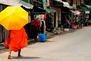 A-Cambodian-monk-walking-no-the-street-in-Phnom-Penh.jpg