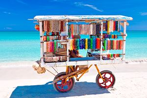 Cart-selling-typical-souvenirs-on-the-beautiful-cuban-beach-of-Varadero.jpg