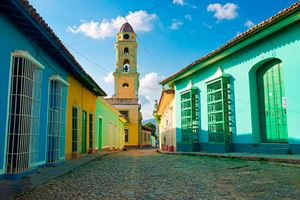 Colorful-traditional-houses-and-old-church-in-the-colonial-town-of-Trinidad-in-Cuba.jpg