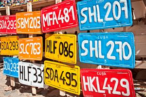 Traditional-handcrafted-vehicle-registration-plates-like-souvenirs-for-sale-in-Trinidad.jpg