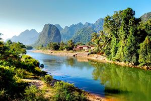 Surreal-landscape-by-the-Song-river-at-Vang-Vieng.jpg