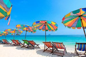 Beach-chair-and-colorful-umbrella-on-the-beach-,-Phuket.jpg