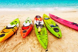 Colorful-kayaks-on-the-tropical-beach.jpg