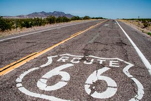 long-road-with-a-Route-66-sign-painted-on-it-(motorcycle).jpg