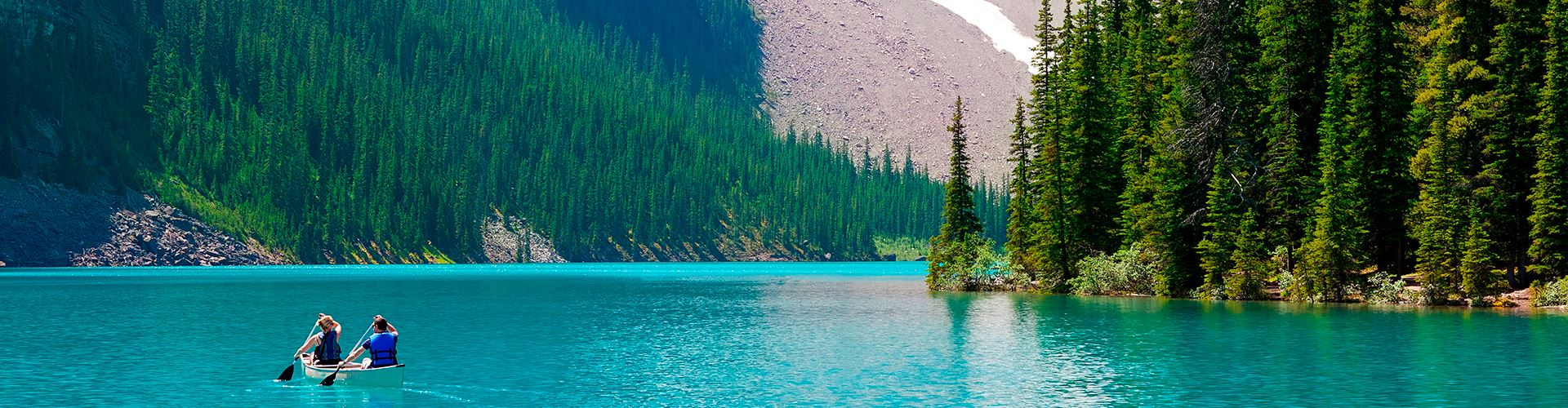 Boating-at-beautiful-moraine-lake-at-banff-national-park,-alberta,-canada.jpg