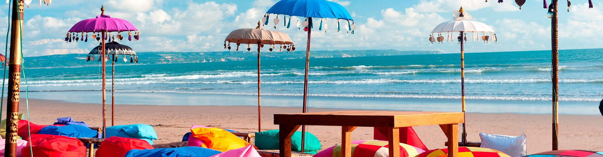 Colorful-beach-umbrellas-and-pillows-in-Kuta.jpg