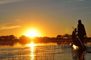 Saling-in-the-Okavango-delta-at-sunset,-Botswana.jpg