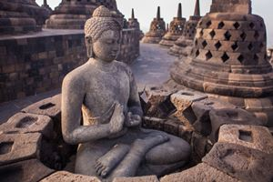 Buddha-statue-in-Buddist-temple-of-Borobudur-in-the-morning.-Yogyakarta.jpg