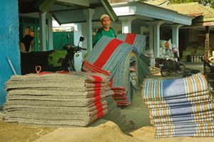 Pile-of-traditional-colorful-carpet,-Taken-at-Mendongan-Handicraft,-Malang,-east-Java.jpg